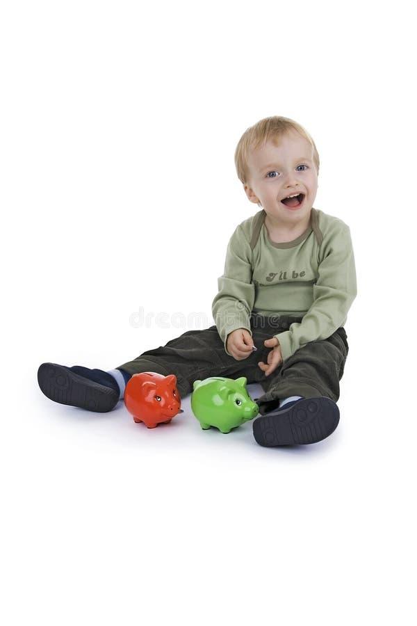 Savings little boy stock photos