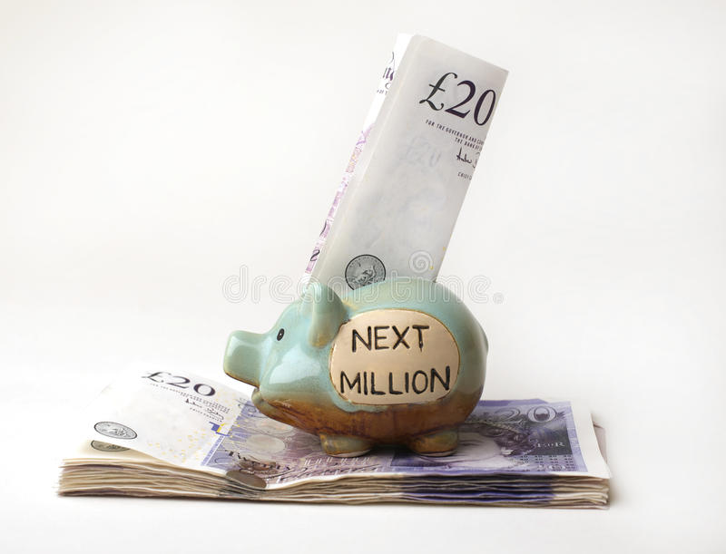 Savings in a Piggy Bank stock images