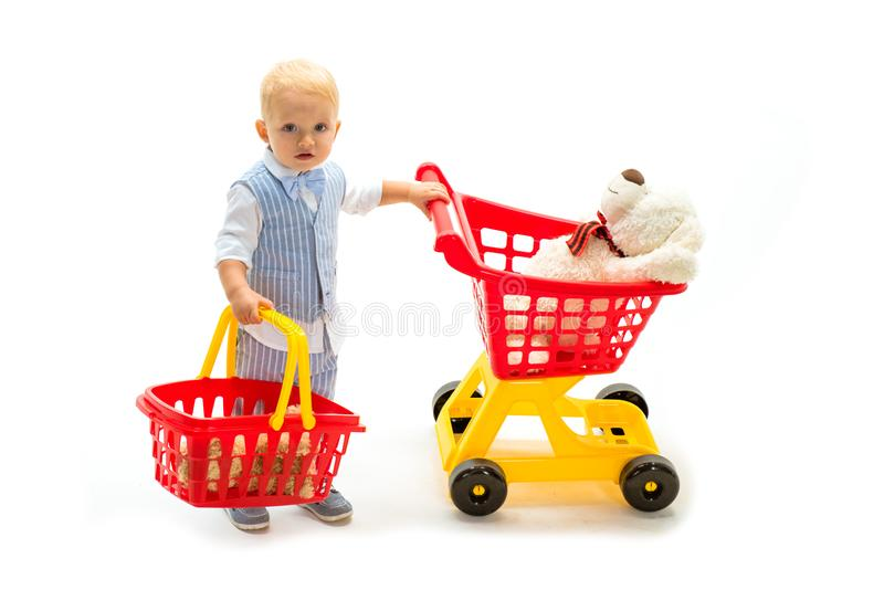 Savings on purchases. little boy go shopping with full cart. happy childhood and care. shopping for children. little boy. Child in toy shop. Excitement stock images