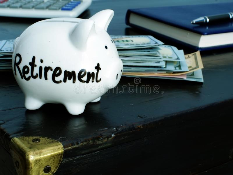 Savings for retirement. Piggy bank on  table. Savings for retirement. Piggy bank on vintage table stock image
