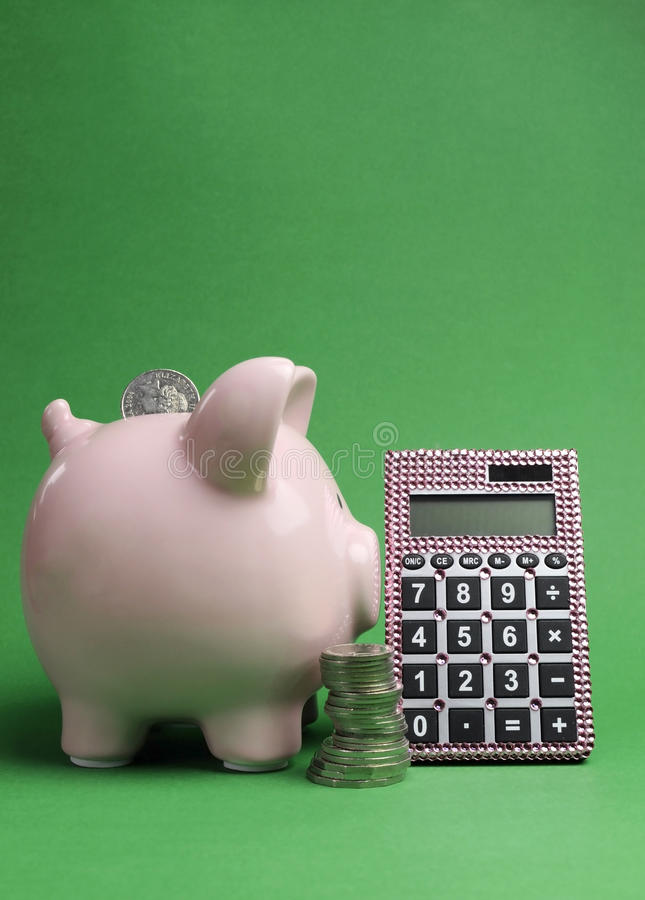 Savings and Shopping Sale concept with piggy bank, stack of coins and calculator - vertical with copy space. Savings and Shopping Sale concept with piggy bank royalty free stock images