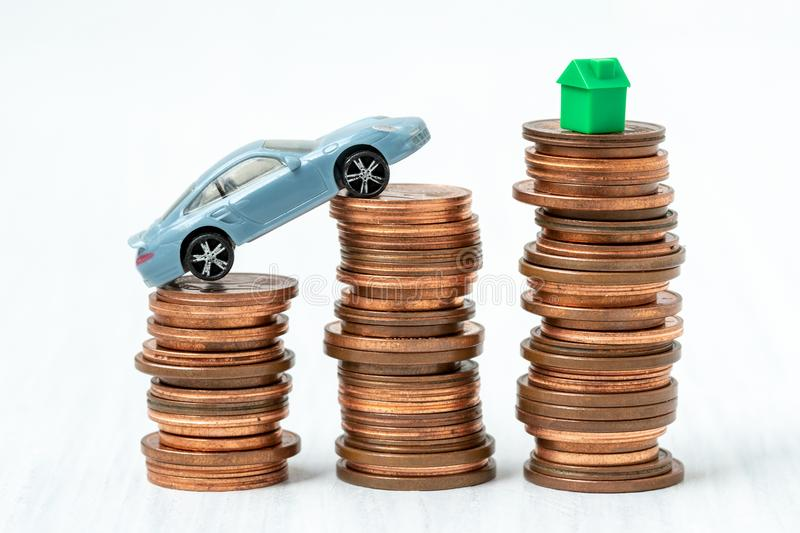 Savings for real estate and car. Savings to buy a home or buy real estate or car. Conceptual image stock photos