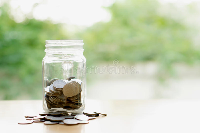 Savings word with money coin in glass jar.financial stock photography