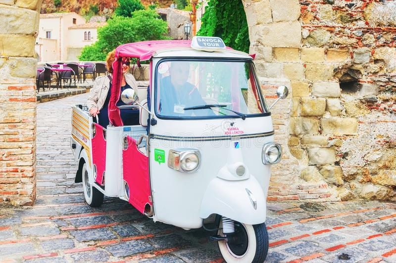 Three wheeled auto rickshaw in Savoca street stock photo