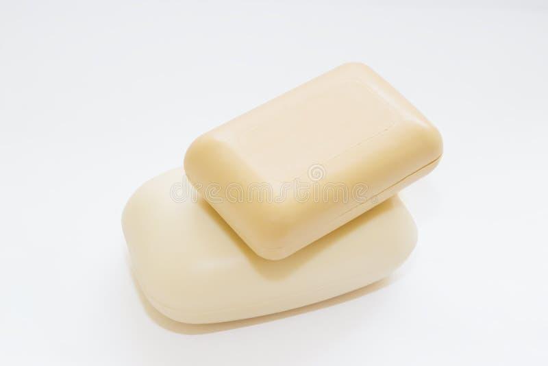 Savon de toilette d'hygiène blanc et crème pour des enfants, en gros plan, image stock