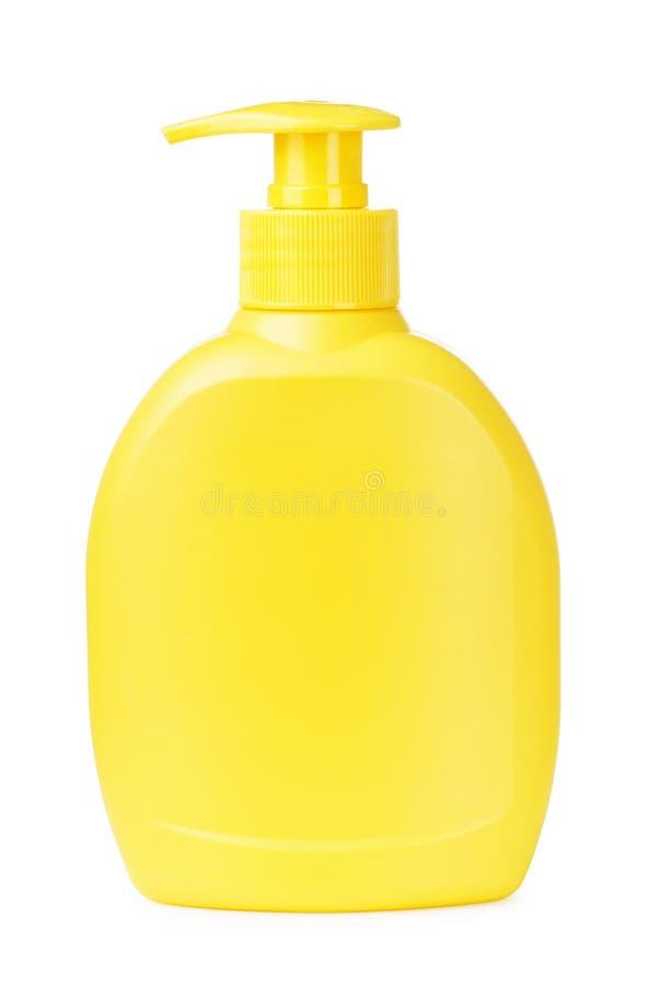 Savon liquide de bouteille jaune photos stock