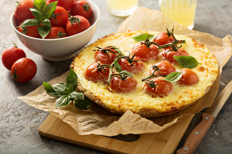 Savory cheese tart with cherry tomatoes. Savory rustic cheese tart with cherry tomatoes stock photo