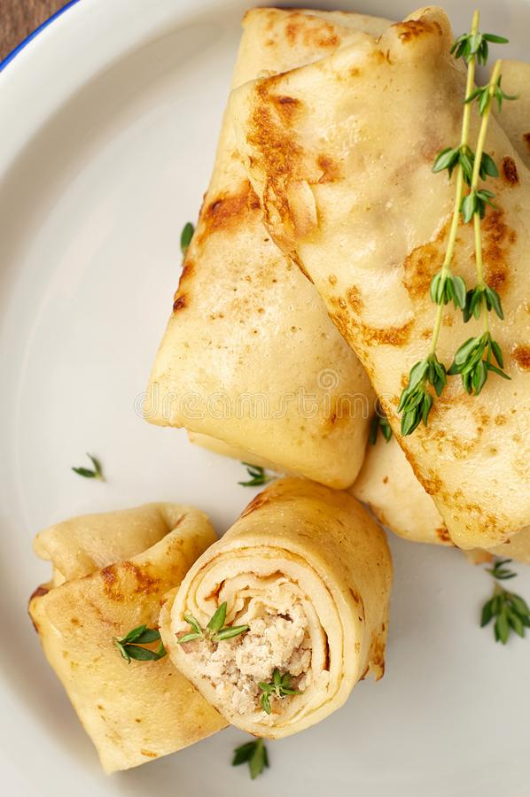 Savory crepe rolls with ground meat filling. Traditional Russian Shrovetide festival meal. Savory crepe rolls with ground meat filling. Traditional Russian royalty free stock photo