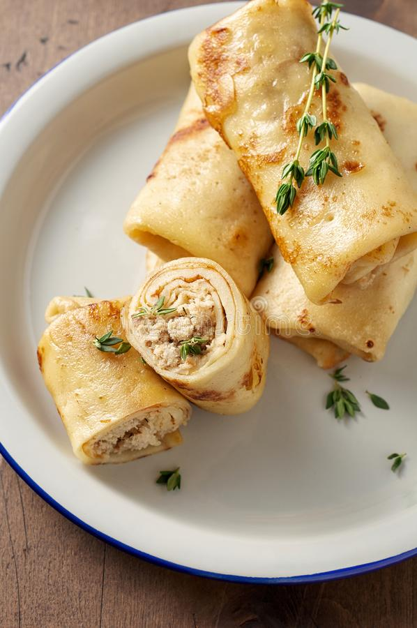 Savory crepe rolls with ground meat filling. Traditional Russian Shrovetide festival meal. Savory crepe rolls with ground meat filling. Traditional Russian stock images
