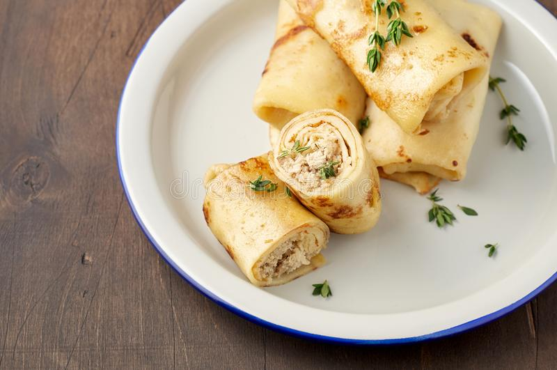 Savory crepe rolls with ground meat filling. Traditional Russian Shrovetide festival meal. Savory crepe rolls with ground meat filling. Traditional Russian royalty free stock photos