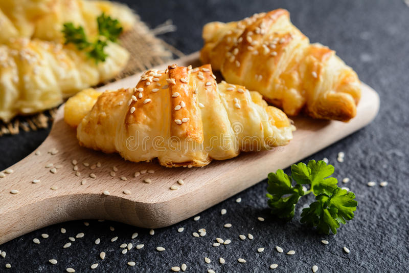 Savory croissants stuffed with Emmental cheese stock photo