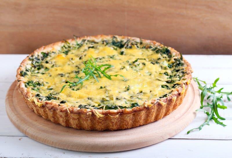 Savory green tart. Selective focus stock images