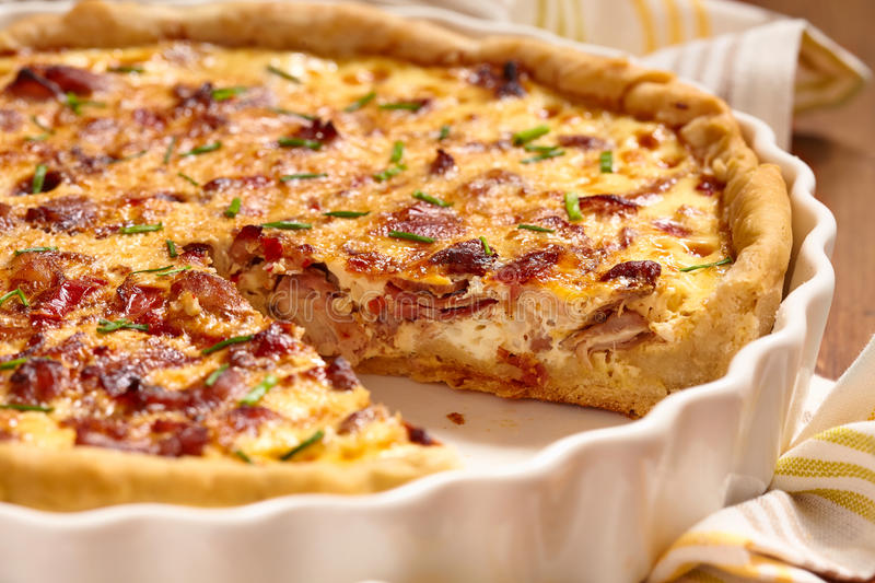 Savory pie with chicken. Bacon, onion and pepper stock image