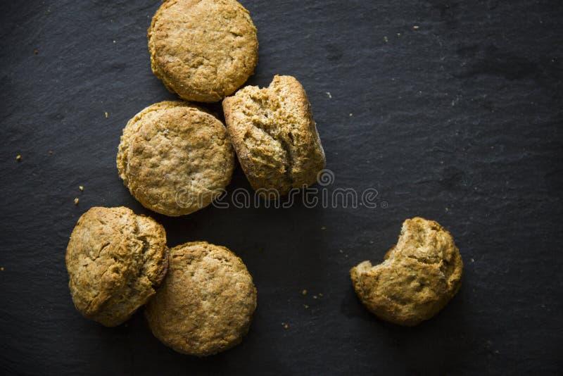 Savory scones. On dark plate stock photos