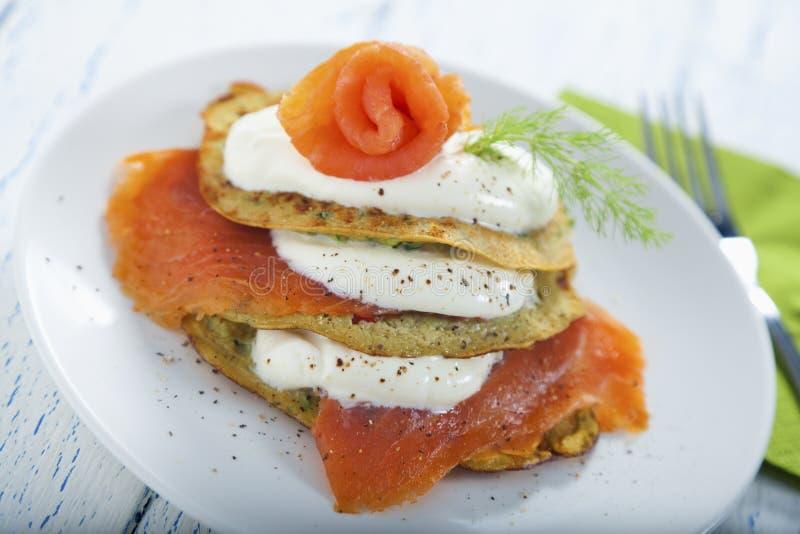 Savoury pancake with salmon and yoghurt royalty free stock photo