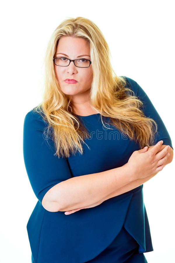 Savvy business woman stares intensely at camera. While standing with her arms crossed stock image