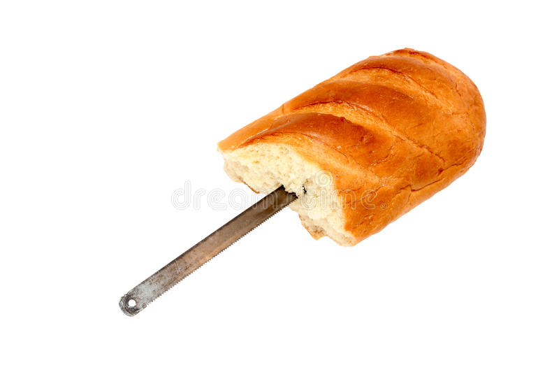 Saw blade hidden in a loaf of bread isolated. On a white background royalty free stock image