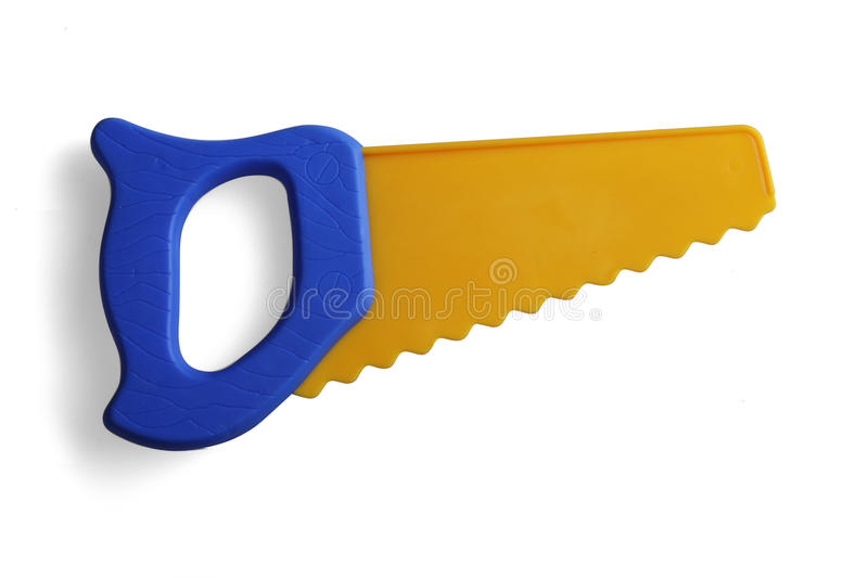 Saw, a plastic toy. On a white background royalty free stock image