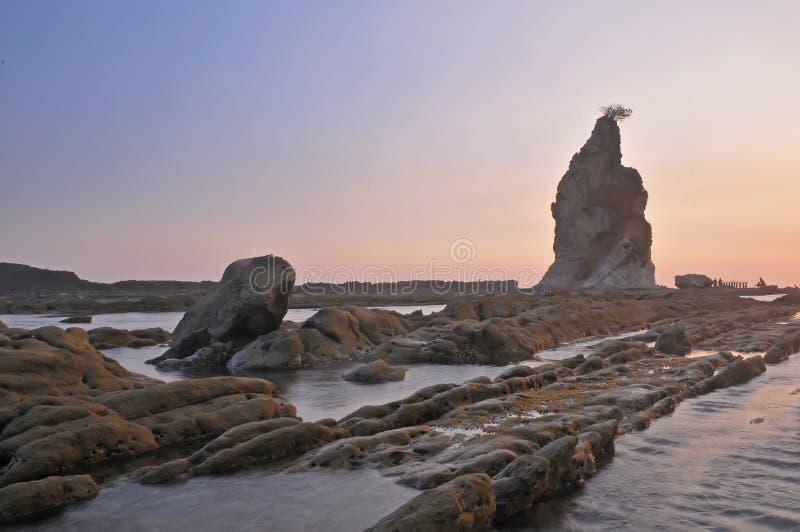 Sawarna great rock. Sunset of Great rock at sawarna beach in banten, indonesia royalty free stock photo