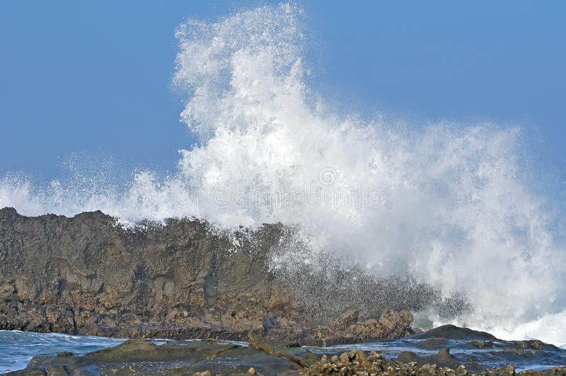 Sawarna great rock. Wave hits Great rock at sawarna beach in banten, indonesia stock photo