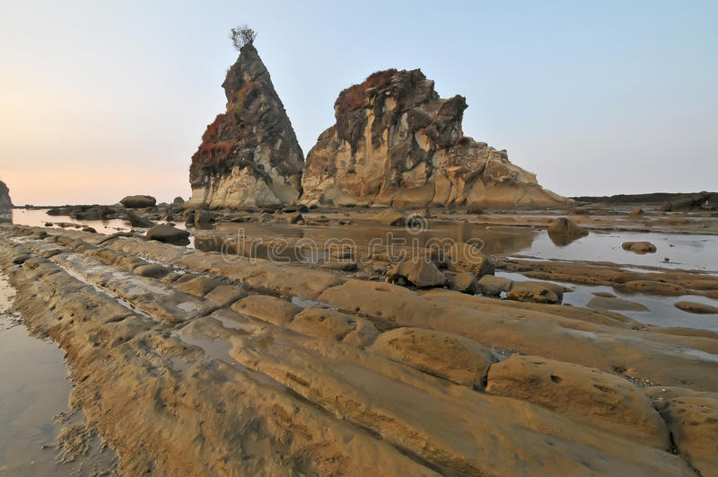 Sawarna great rock. Sunrise of Great rock at sawarna beach in banten, indonesia royalty free stock photo