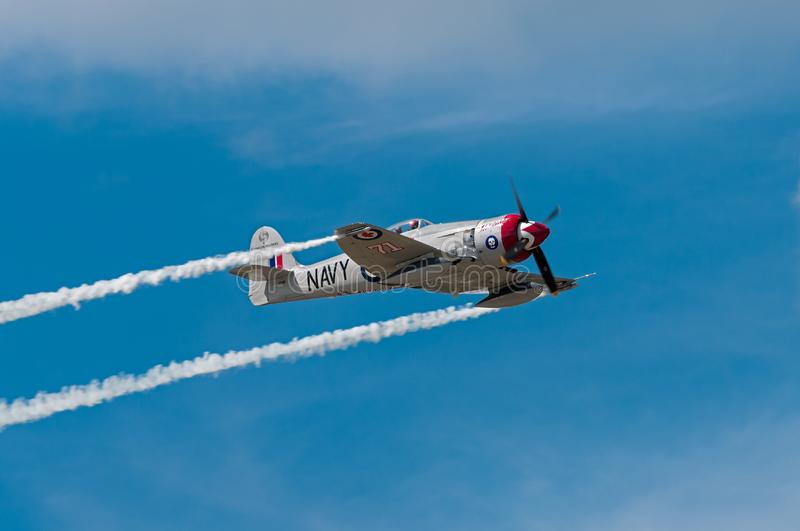 Sawbones Flies Right Across Sky. EDEN PRAIRIE, MN - JULY 16 2016: Hawker Sea Fury FB-11f flies right at air show. The Sea Fury was a British fighter aircraft stock photos