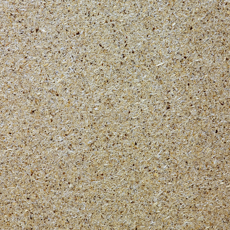 Sawdust board. The surface of wooden textured board royalty free stock images