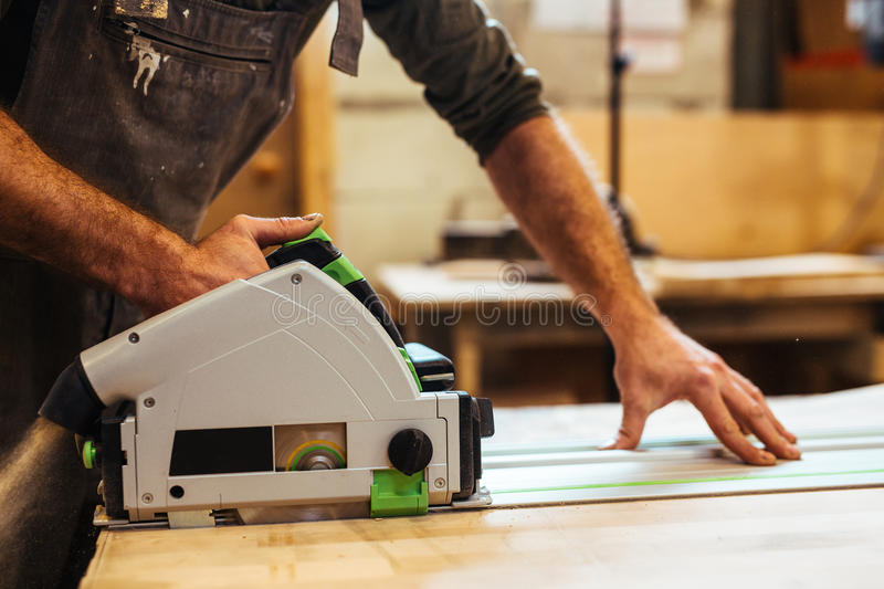 Sawing board. Cabinetmaker cutting board with scroll-saw stock photos