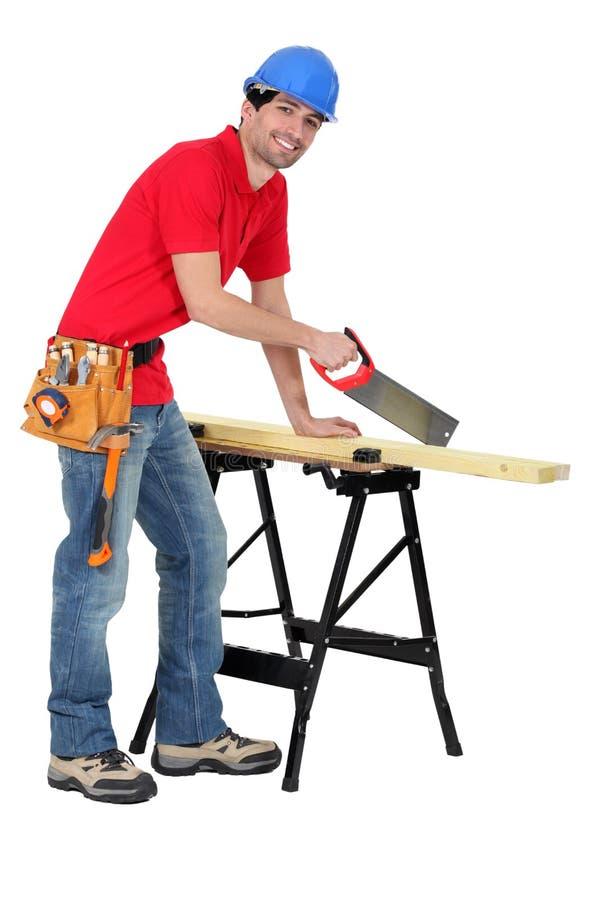 Sawing de charpentier photo libre de droits
