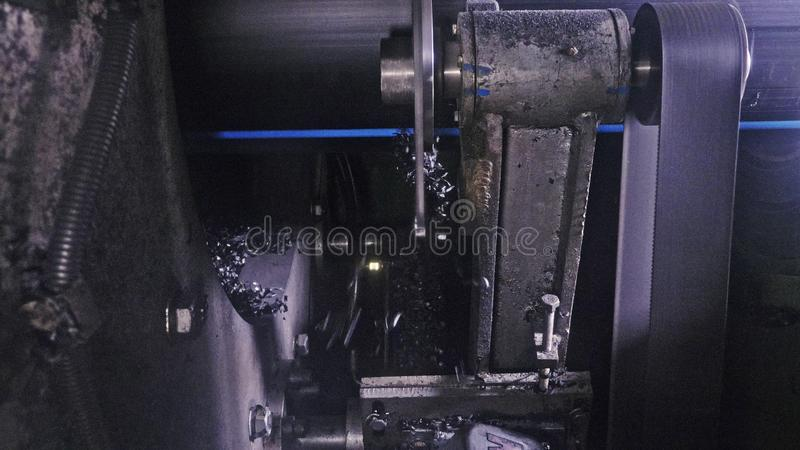 Sawmill circular saw machine. Manufacture of plastic water pipes factory. Process of making plastic tubes on the machine. Sawmill circular saw machine royalty free stock images
