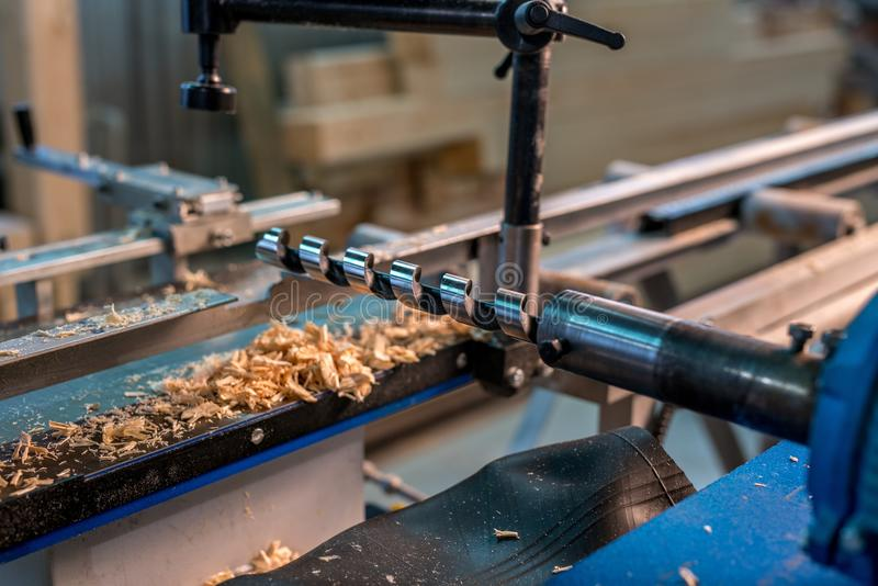 At sawmill. Drill and shavings underneath it royalty free stock images