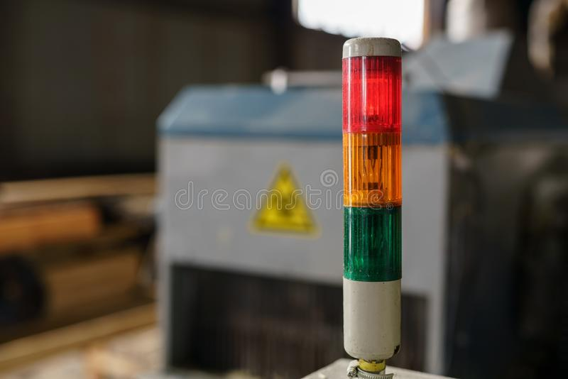At sawmill. Image of tri-color LED on machine royalty free stock photography