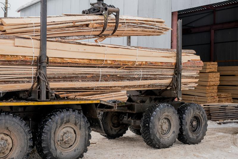 Sawmill. Image of truck transports boards royalty free stock photos