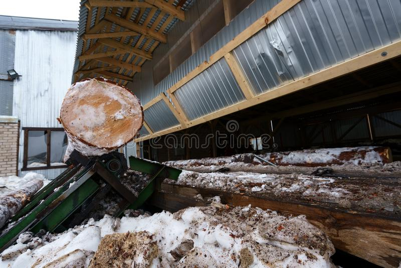 Sawmill in winter. Image of log under roof stock images