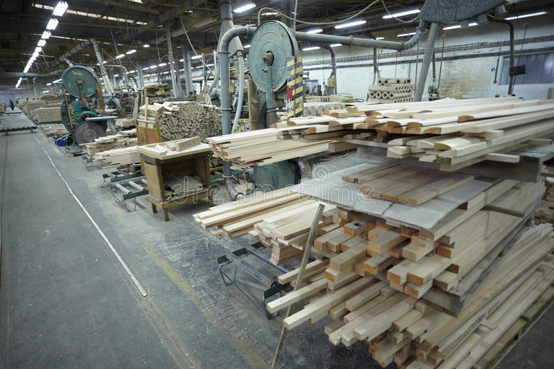 Sawmill wood industry. Interior of a sawmill and wood stack royalty free stock photos