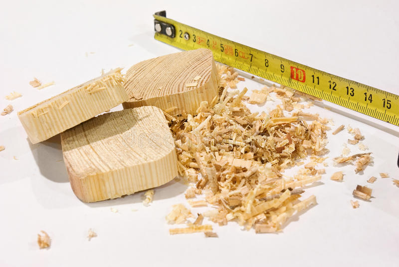 Sawn-off boards (of wood) among the sawdust