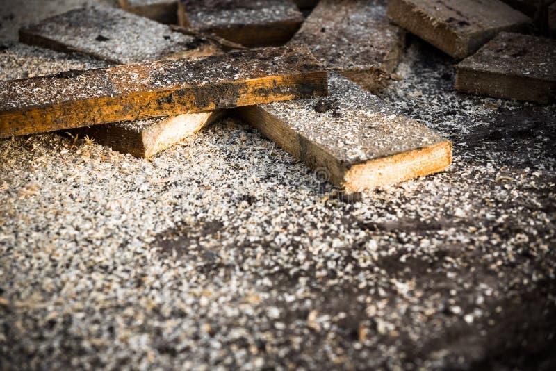 Sawn off pieces of wood. Sawn-off pieces of wood on the concrete floor royalty free stock photos