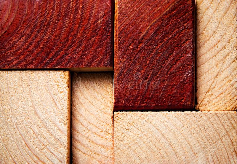 Sawn timber from two-color wood. Abstract background or texture sawn timber from two-color wood royalty free stock photography