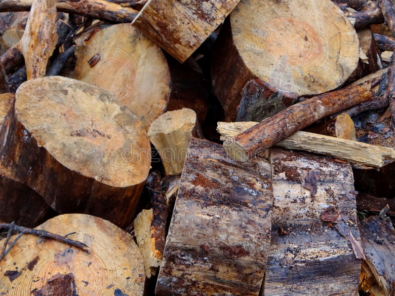 Sawn wood. Sawn into several pieces and lying in heaps royalty free stock image