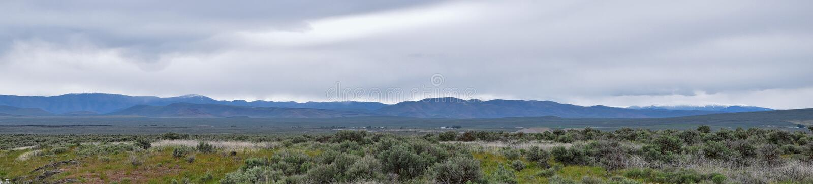 Sawtooth Mountains National Forest Landscape stormy panorama from South headed to Sun Valley, view of rural grazing land, Sagebrus royalty free stock photos