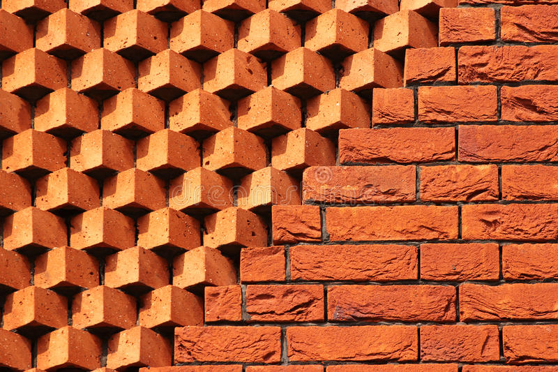 Sawtooth pattern brickwork. Decorative red brick wall as background stock photos