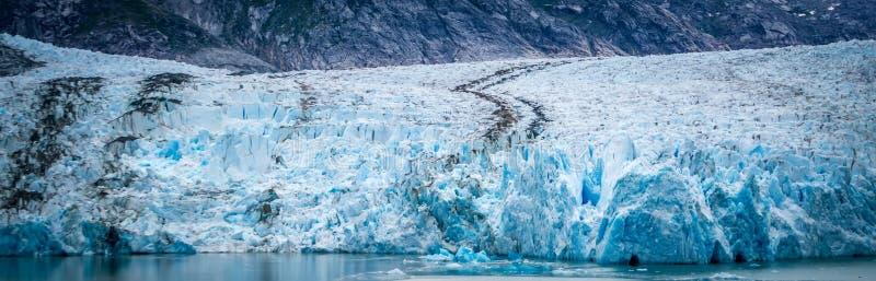 Sawyer Glacier på Tracy Arm Fjord i den alaska stekpannehandtaget arkivfoton