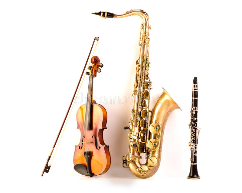 Sax tenor saxophone violin and clarinet in white. Music Sax tenor saxophone violin and clarinet in white background stock photos