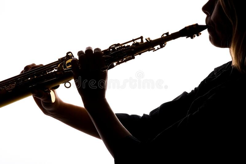 Saxafon on a white background in the hands of a musician silhouette royalty free stock image