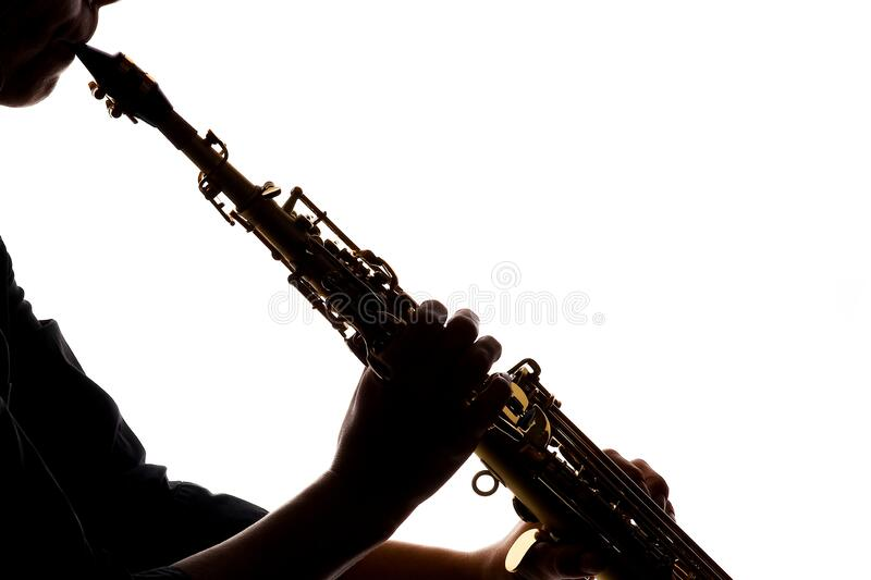 Saxafon on a white background in the hands of a musician silhouette stock photo