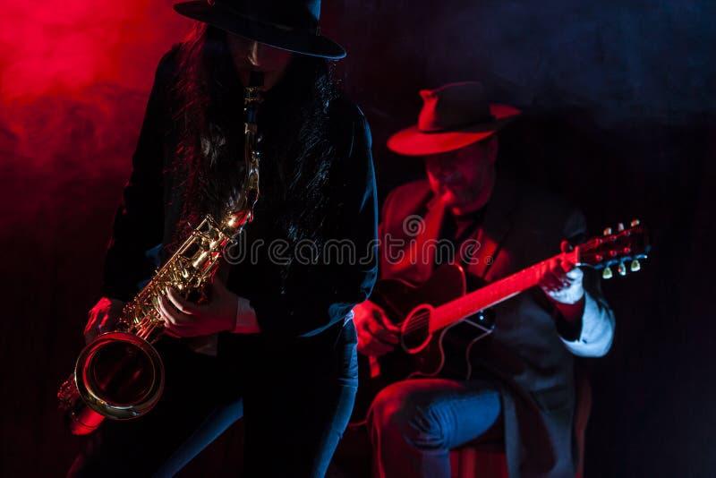 Saxofoon en Gitaar royalty-vrije stock afbeelding