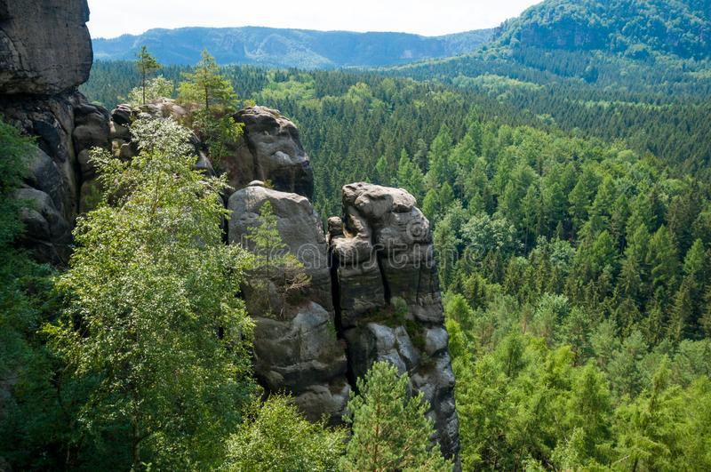 Saxon Switzerland National Park rocky and green trees landscape. Saxon Switzerland National Park in the German Free State of Saxony, near the Saxon capital royalty free stock photo