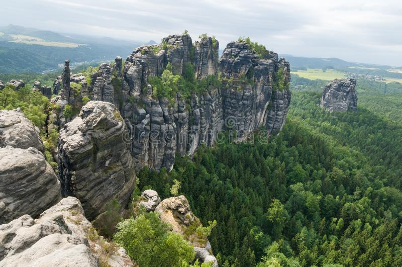 Saxon Switzerland rocky and green trees landscape. Saxon Switzerland National Park in the German Free State of Saxony, near the Saxon capital Dresden part of the stock photography