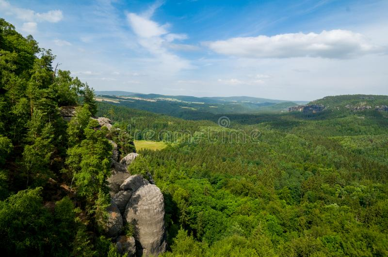 Saxon Switzerland rocky and green trees landscape. Saxon Switzerland National Park in the German Free State of Saxony, near the Saxon capital Dresden part of the stock image