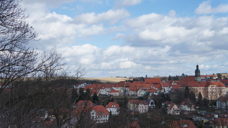 Saxon town in the Eastern Ore Mountains. View of a Saxon town in the Eastern Ore Mountains in Germany, at the center the castle with the tower of the town church royalty free stock photography
